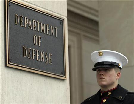 A United States Marine stands by his post in front of the Pentagon in Washington February 29, 2012. REUTERS/Gary Cameron