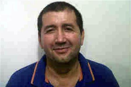 Alleged Colombian drug trafficker Daniel Barrera, known as ''Loco Barrera'', is seen in this handout photo provided by the national police on September 18, 2012. REUTERS/National Police