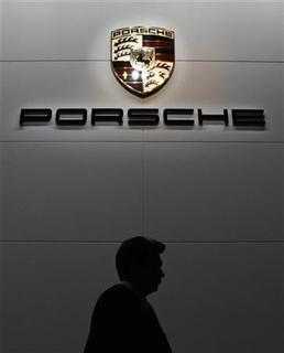 A visitor passes by a Porsche stand during the Moscow International Automobile Salon August 31, 2012. REUTERS/Maxim Shemetov
