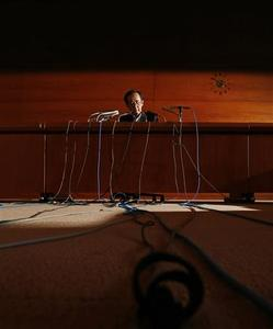 Bank of Japan Governor Masaaki Shirakawa is seen underneath a table during his news conference in Tokyo September 19, 2012. Shirakawa said on Wednesday that Japan's economic recovery may be delayed by six months due to a prolonged slowdown in global growth. REUTERS/Kim Kyung-Hoon