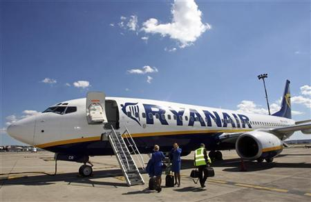 Ryanair crew stand in front of a passenger jet on the tarmac of Marignane airport in Marseille in this May 10, 2006 file photo. REUTERS/Jean-Paul Pelissier/Files