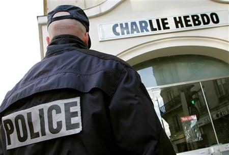 A policeman stands guard outside the French satirical weekly ''Charlie Hebdo'' in Paris, February 9, 2006. REUTERS/Regis Duvignau/Files