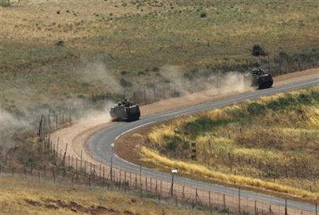 Israeli armoured personnel carriers (APC) drive along the Israeli-Syrian border near the Druze village of Buqata in the Golan Heights July 23, 2012. REUTERS/Baz Ratner