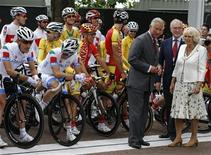 Britian's Prince Charles and Camilla, Duchess of Cornwall, stand in front of participants of the men's road cycling race at the London 2012 Olympic Games at The Mall July 28, 2012. REUTERS/Phil Noble