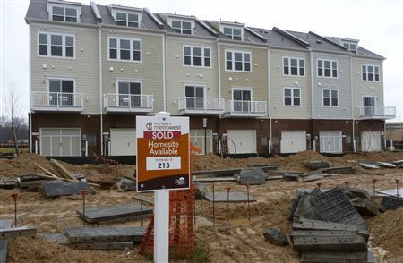 A sold sign stands outside a new townhouse construction site in Fairfax, Virginia, outside Washington in this file photo taken February 29, 2012. REUTERS/Larry Downing/Files