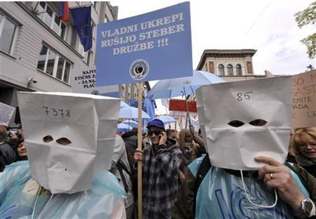 Members of the union attend a public workers strike in Ljubljana April 18, 2012. REUTERS/Srdjan Zivulovic