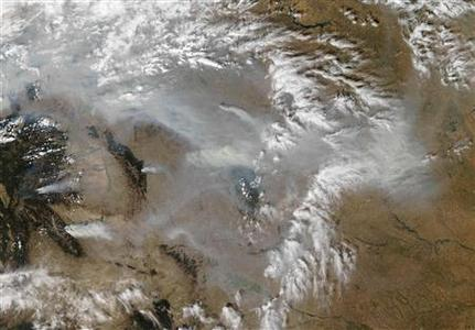 Smoke rising from numerous wildfires burning in Montana and Idaho is seen in this NASA satellite handout image taken September 15, 2012. A warming trend has contributed to a sharp rise in the number and size of wildfires on forest lands in the U.S. West, where big burns are likely to become the norm, according to a report released September 18 by a climate research group. REUTERS/Jeff Schmaltz/LANCE MODIS Rapid Response Team/NASA/Handout