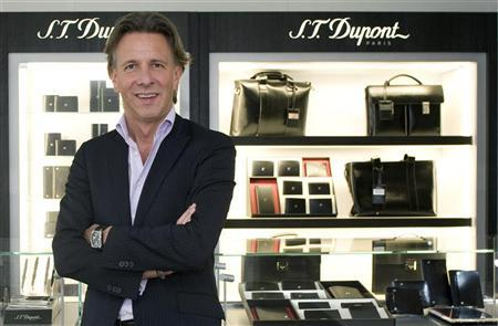 Alain Crevet of the luxury goods brand S.T. Dupont poses at his store in Paris May 28, 2009. REUTERS/Gonzalo Fuentes