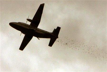 A Royal Thai airforce plane drops paper birds over the southern Thailand province of Pattani, nearly 1055 km (655 miles) south of Bangkok on December 5, 2004. REUTERS/Adrees Latif/Files
