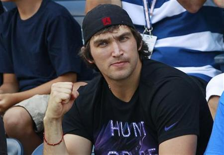 Hockey player Alex Ovechkin watches Maria Kirilenko of Russia play Andrea Hlavackova of the Czech Republic during their women's singles match at the U.S. Open tennis tournament in New York September 1, 2012. REUTERS/Kevin Lamarque