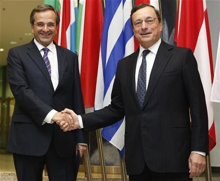 Greece's Prime Minister Antonis Samaras (L) shakes hands with European Central Bank (ECB) President Mario Draghi as he arrives at the ECB headquarters in Frankfurt September 11, 2012. REUTERS/Alex Domanski