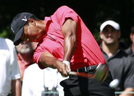 Tiger Woods of the U.S. hits his tee shot on the second tee during the final round of the PGA Championship golf tournament in Carmel, Indiana September 9, 2012. REUTERS/Brent Smith