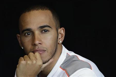 McLaren Formula One driver Lewis Hamilton of Britain attends a promotion event ahead of the Singapore F1 Grand Prix September 19, 2012. The Singapore F1 night race will take place on September 21-23. REUTERS/Tim Chong