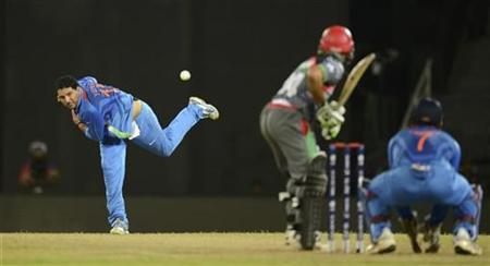 Yuvraj Singh (L) bowls during their ICC World Twenty20 group A match against Afghanistan at the R Premadasa Stadium in Colombo September 19, 2012. REUTERS/Philip Brown