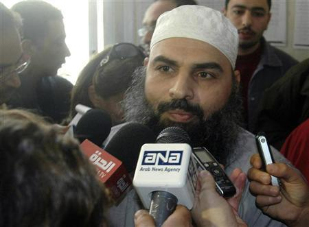 Egyptian cleric Hassan Mustafa Osama Nasr, also known as Abu Omar, speaks to the media at a court house in Alexandria February 22, 2007. REUTERS/Stringer
