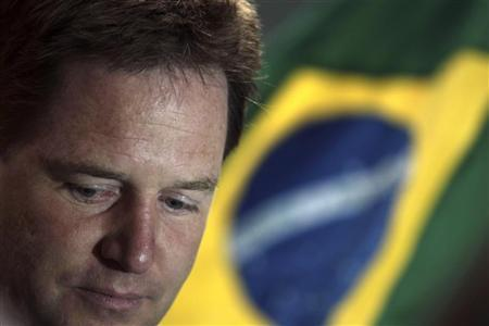 Deputy Prime Minister Nick Clegg talks with journalists during a visit at the Maracana Stadium Complex, undergoing renovations for the 2014 World Cup, in Rio de Janeiro June 21, 2012. REUTERS/Ricardo Moraes