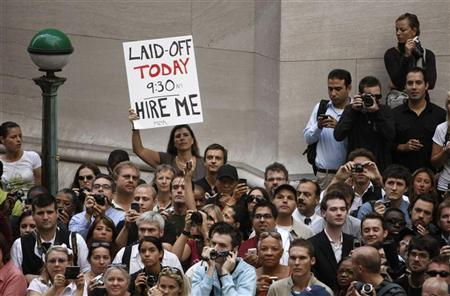 A crowd of onlookers are gathered outside the historic Federal Hall where U.S. President Barack Obama was speaking in the heart of Wall Street in New York, September 14, 2009. REUTERS/Larry Downing