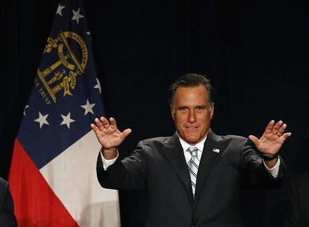U.S. Republican presidential nominee and former Massachusetts Governor Mitt Romney gestures as he tells the audience to sit down during a standing ovation at his arrival to a campaign fundraising event in Atlanta, Georgia, September 19, 2012. REUTERS/Jim Young