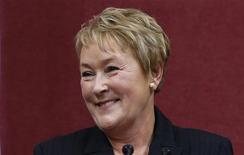 Quebec's Premier Pauline Marois smiles after being sworn-in at the National Assembly in Quebec City, September 19, 2012. REUTERS/Mathieu Belanger