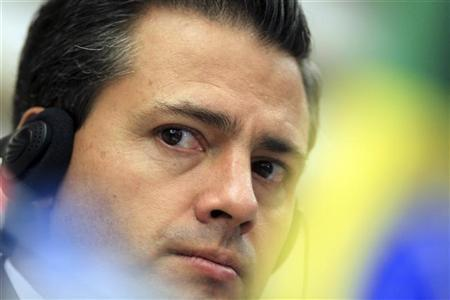 Mexico's President-elect Enrique Pena Nieto attends a media conference after a business meeting at the FIESP (Sao Paulo Industry Federation) in Sao Paulo September 19, 2012. REUTERS/Paulo Whitaker