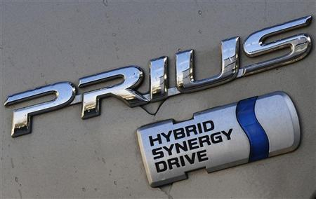 A Toyota Prius' badge is pictured on a car at a Toyota dealership in west London February 9, 2010. REUTERS/Toby Melville