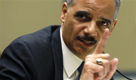 U.S. Attorney General Eric Holder testifies before a House Oversight and Government Reform Hearing on ''Fast & Furious: Management Failures at the Department of Justice'' in Washington in this file photo taken February 2, 2012. REUTERS/Kevin Lamarque/Files