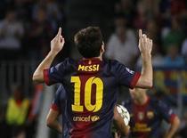 O argentino Lionel Messi comemora gol do Barcelona contra o Spartak Moscou. REUTERS/Gustau Nacarino