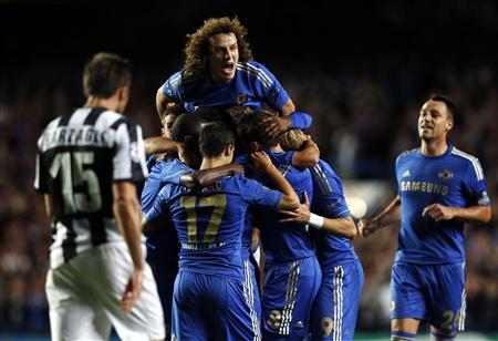 Chelsea's Oscar (unseen) celebrates with teammates after scoring a goal against Juventus during their Champions League soccer match at Stamford Bridge in London September 19, 2012. REUTERS/Eddie Keogh