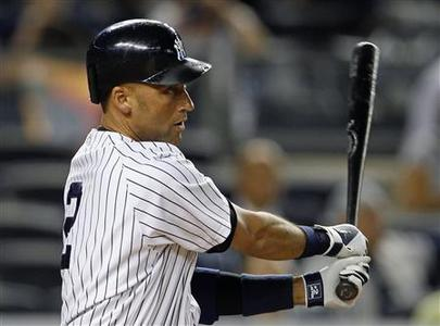 New York Yankees' Derek Jeter watches a single against the Toronto Blue Jays during the first inning of their MLB American League baseball game at Yankee Stadium in New York September 19, 2012. The hit was his 200th of the season for the 8th time in his major league career, tying Lou Gehrig's franchise record. REUTERS/Adam Hunger