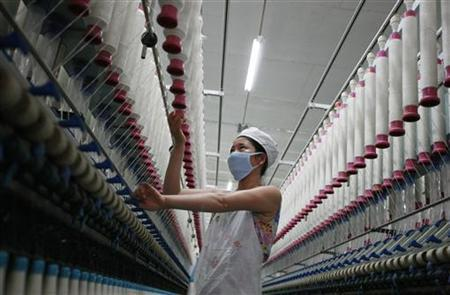 A labourer works at a textile mill in Huaibei, Anhui province August 1, 2012. REUTERS/Stringer/Files