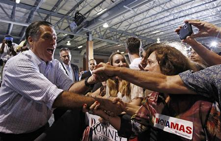 U.S. Republican presidential nominee and former Massachusetts Governor Mitt Romney (L) greets supporters at a campaign rally in Miami, Florida September 19, 2012. REUTERS/Jim Young