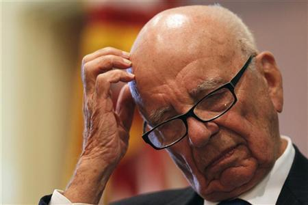 News Corp Chairman and CEO Rupert Murdoch listens to a speaker at the ''The Economics and Politics of Immigration'' Forum in Boston, Massachusetts August 14, 2012. REUTERS/Jessica Rinaldi
