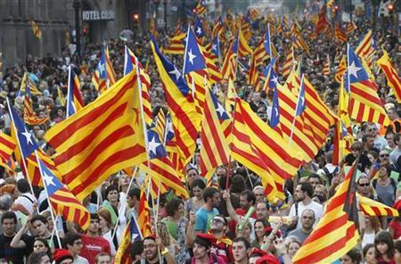 Marchers wave Catalonian nationalist flags as they demonstrate during Catalan National Day in Barcelona September 11, 2012. REUTERS/Albert Gea