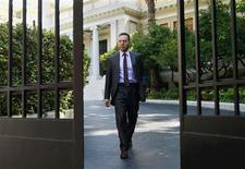 Greek Finance Minister Yannis Stournaras leaves after a meeting with Prime Minister Antonis Samaras at the Prime Minister's office in Athens September 20, 2012. Greece's latest round of talks with lenders on an austerity plan was marked by moments of tension as the two sides squabbled over a plan to reform the country's bloated public sector, government officials told Reuters on Thursday. REUTERS/John Kolesidis