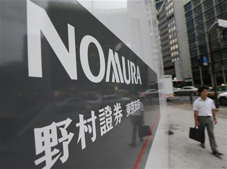 A man walks past a sign of Nomura Securities in Tokyo September 6, 2012. REUTERS/Kim Kyung-Hoon