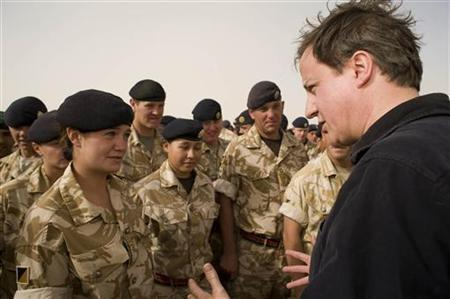 Britain's Prime Minister David Cameron (R) speaks to British forces at Camp Bastion in Helmand Province, Afghanistan June 11, 2010. REUTERS/Sergeant Ian Forsyth RLC/MoD/Crown Copyright/Handout