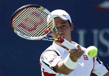 Kei Nishikori of Japan hits a return to Tim Smyczek of the U.S. during their men's singles match at the U.S. Open tennis tournament in New York August 30, 2012. REUTERS/Kena Betancur