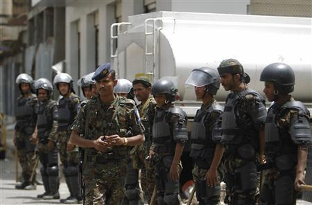 Riot policemen stand guard outside the French embassy in Sanaa September 20, 2012. A French magazine ridiculed the Prophet Mohammad on Wednesday by portraying him naked in cartoons, threatening to fuel the anger of Muslims around the world who are already incensed by a California-made video depicting him as a lecherous fool. REUTERS/Khaled Abdullah