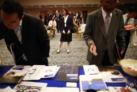 People participate in a job fair in New York June 11, 2012. REUTERS/Eric Thayer