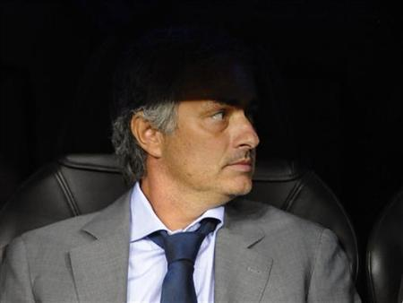 Real Madrid's coach Jose Mourinho takes his seat before the start of their Champions League Group D soccer match against Manchester City at the Santiago Bernabeu stadium in Madrid, September 18, 2012. REUTERS/Felix Ordonez