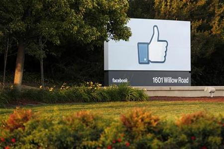The sun sets on the entrance sign at Facebook's headquarters in Menlo Park, California, the night before the company's IPO launch, May 17, 2012. REUTERS/Beck Diefenbach/Files