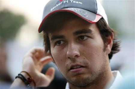 Sauber Formula One driver Sergio Perez of Mexico speaks to journalists in the paddock ahead of the Singapore F1 Grand Prix September 20, 2012. REUTERS/Edgar Su