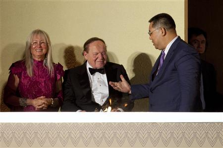 Macau Chief Executive Fernando Chui Sai-On chats with Las Vegas Sands Chairman and CEO Sheldon Adelson (C) and his wife Miriam Ochsorn (R) during the opening ceremony of Sheraton Macao hotel at Sands Cotai Central in Macau September 20, 2012. U.S. billionaire Adelson opened his latest resort in Macau on Thursday, adding to a string of casinos in the world's largest gambling destination that has helped the high-profile donor to the U.S. Republican party earn most of his multi-billion dollar fortune. REUTERS/Tyrone Siu