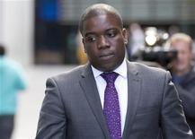 Former UBS trader Kweku Adoboli leaves Southwark Crown Court in London September 14, 2012. Adoboli, who was arrested a year ago when a loss of $2.3 billion came to light, is charged with fraud and false accounting. REUTERS/Neil Hall