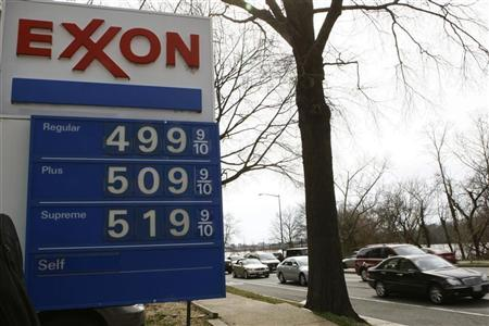 Gasoline (regular grade) prices hover at one-tenth of a cent under the $5.00 mark at an Exxon station in Washington March 2, 2012. REUTERS/Gary Cameron