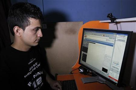 An Afghan man browses the YouTube website at a public internet cafe in Kabul September 12, 2012. REUTERS/Mohammad Ismail