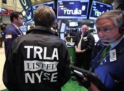 Traders work at the post that trades Trulia Inc. on the floor of the New York Stock Exchange, September 20, 2012. REUTERS/Brendan McDermid