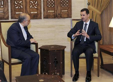 Syria's President Bashar al-Assad (R) meets Iran's Foreign Minister Ali Akbar Salehi in Damascus September 19, 2012, in this handout photograph released by Syria's national news agency SANA. REUTERS/SANA