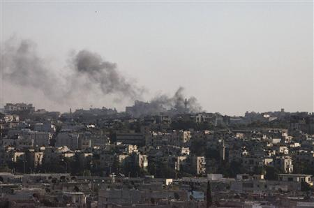Smoke rises above Aleppo after a heavy jet strike on the city September 19,2012. REUTERS/Zain Karam