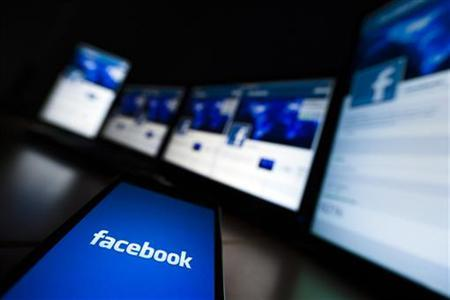 The loading screen of the Facebook application on a mobile phone is seen in this photo illustration taken in Lavigny May 16, 2012. REUTERS/Valentin Flauraud